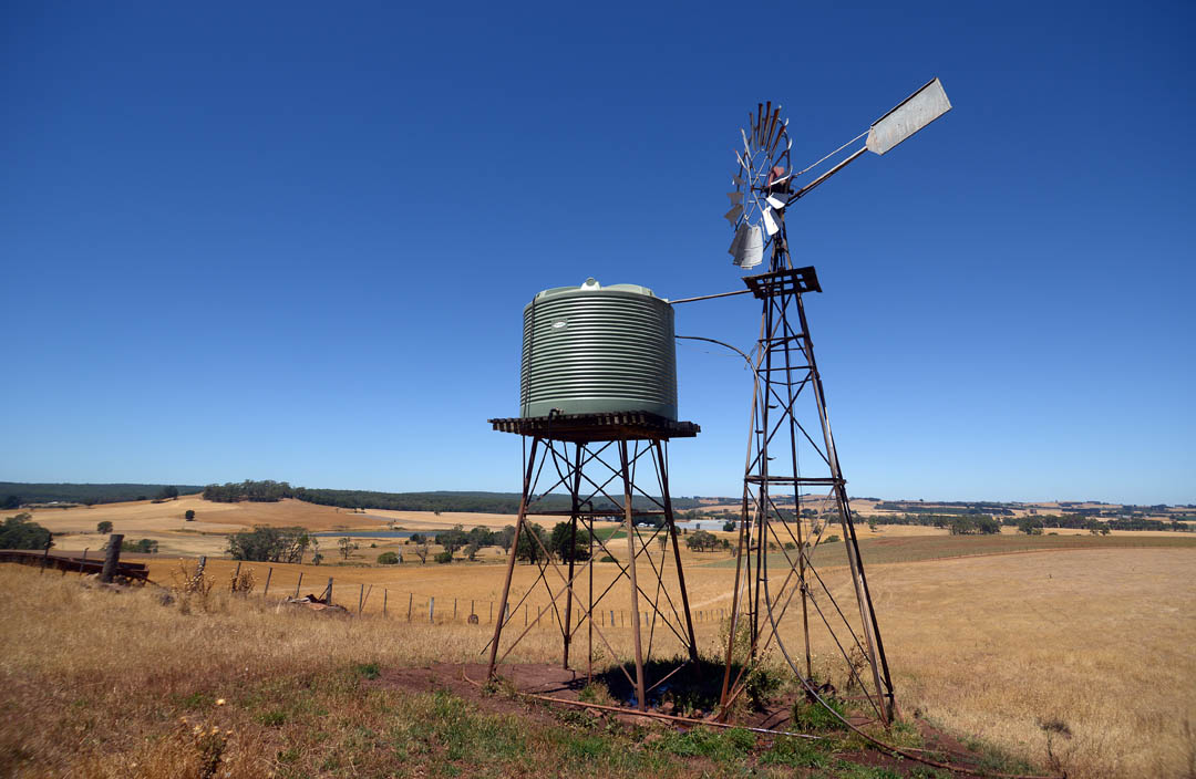 Plastic water tank and windmill
